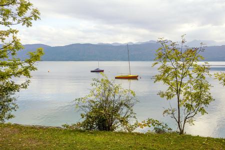 moored: mountain lake walchensee with moored sailboats, bavarian alps