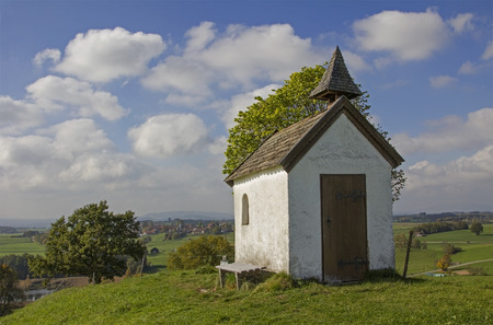pictorial: pictorial rural landscape with little chapel at he hill, upper bavaria