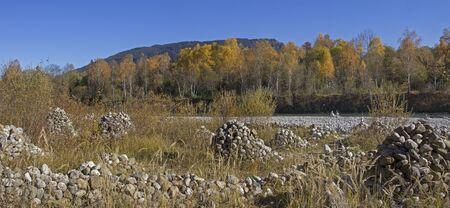 landscape riverside: riverside of isar river with stone heaps, bavarian autumnal landscape