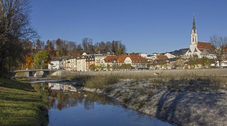 town idyll: view to old town bad tolz and isar river, tranquil autumn scenery