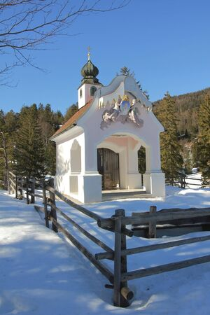 pictorial: pictorial chapel in wintry landscape, upper bavaria Stock Photo