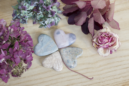 four leaf clover - figured with heart shaped soap stone and dried hydrangea blossoms. Stock Photo