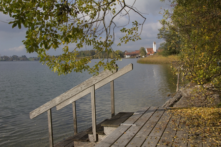 lake riegsee in autumn, boardwalk with steps into the water, upper bavaria