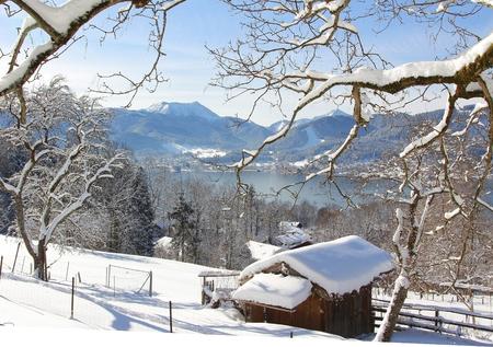 excursion: winter excursion through snowy landscape with view to lake tegernsee, bavaria Stock Photo