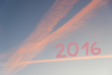 turns of the year: blue sky background with pink clouds, year 2016 numerics