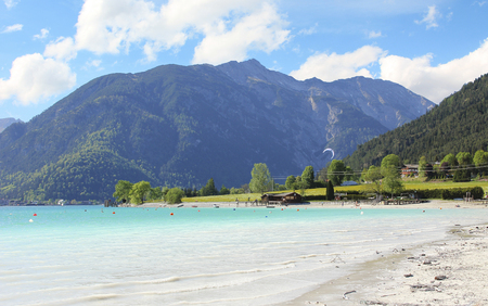 kiting: beautiful lake achensee with turquoise water, and sandy beach at springtime, austria.