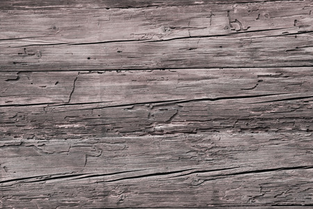 russet: rustic wooden background - old timber facade with wormholes Stock Photo