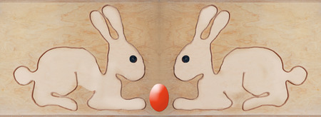 adverse: two bunnies sitting adverse, shape with string formed. Easter background.