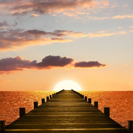 sunset ocean scenery with wooden boardwalk to the endless horizon