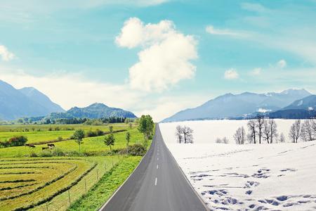 mountainous: country road through mountainous winter and spring landscape, seasons rotation Stock Photo