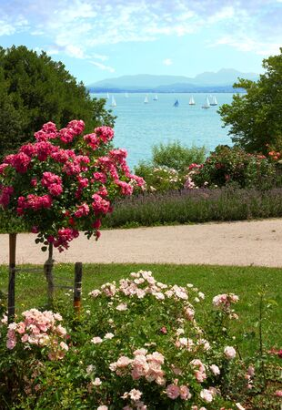 pictorial: pictorial lakeside promenade with roses at gstadt and chiemsee lake, bavaria