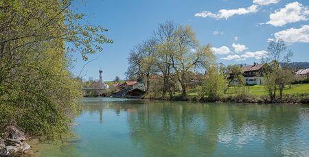 town idyll: mangfall river at health resort gmund, bavarian springtime landscape