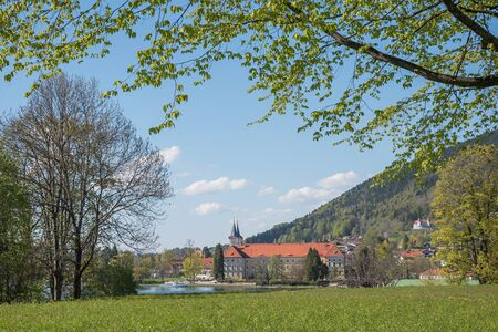 tegernsee castle and brewery, view through green branches, upper bavaria
