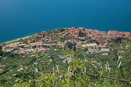 birds eye: birds eye view from the mountain to gargnano village and lake garda, italian landscape