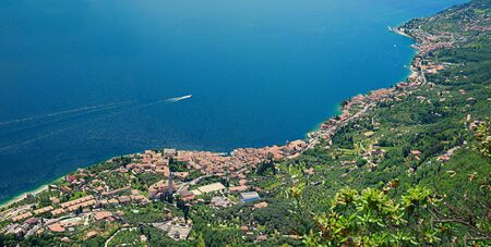 eye traveller: birds eye view garda lake west coastline, gargnano and bogliaco, italy, view from the mountain trail