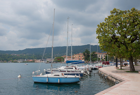 salo: lakeside promenade salo, garda lake italy, with sailboats