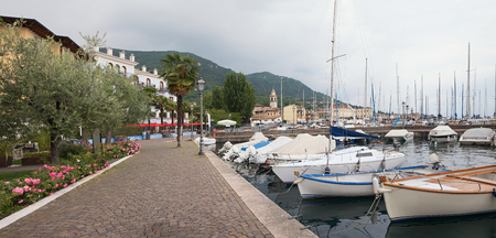 salo: idyllic lakeside promenade salo, garda lake italy, with moored sailboats
