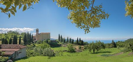 pictorial: pictorial landscape above garda lake, sasso village with church on the hill
