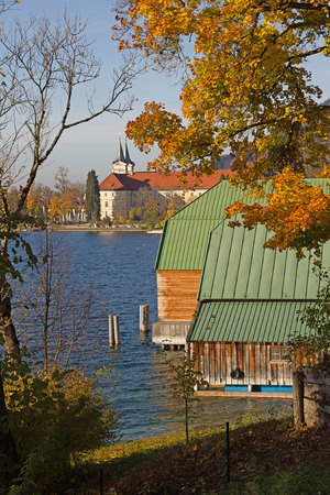 boathouse: idyllic lake tegernsee in autumn, boathouse and view to the castle brewery, upper bavaria