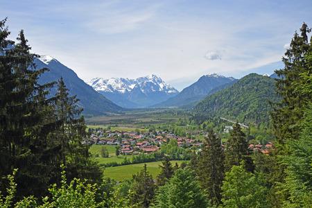 zugspitze mountain: alpine landscape with view to eschenlohe village and zugspitze mountain, upper bavaria Stock Photo