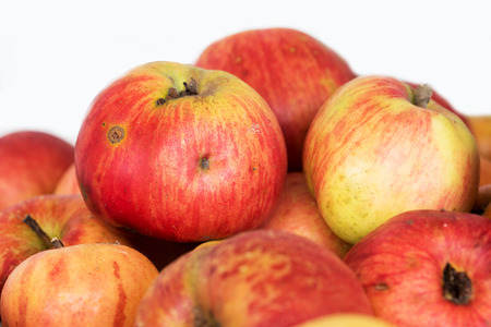 group of ripe untreated apples on white background Stock Photo