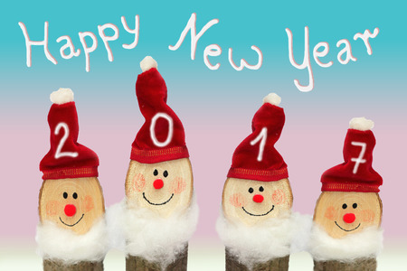 gnomos: Happy New Year 2017 - Four Gnomes with smiling face against pink and blue background