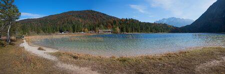 panoramic view alpine lake ferchensee near mittenwald in autumn, upper bavaria