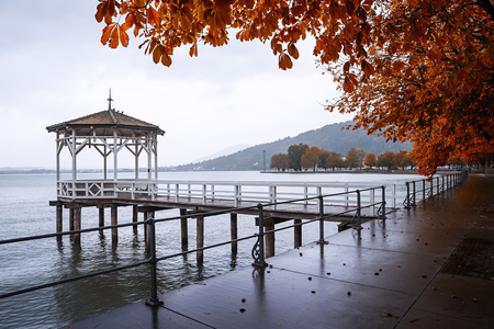 wooden pavilion at the pier, autumnal scenery after the rain, lake constance, germany Stock Photo