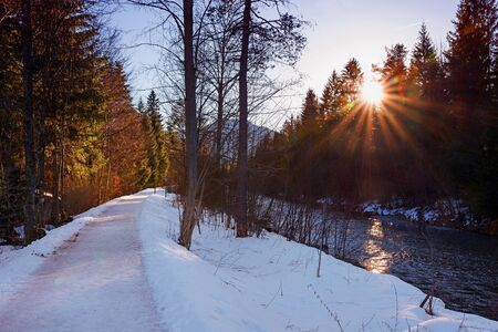 riverside landscape: riverside walkway in winter, bavarian landscape