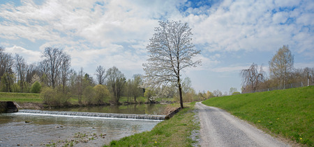 riverside landscape: bicycle route along the riverside of mangfall river, bavarian springtime landscape