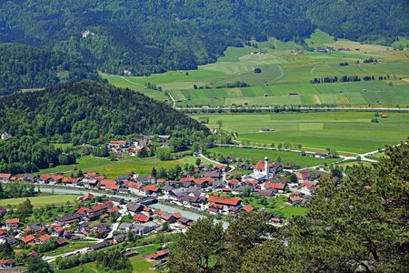 view from mountain to idyllic eschenlohe village and loisach river, upper bavaria Stock Photo