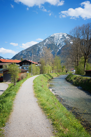 pedestrian walkway at the rottach riverside towards wallberg, upper bavaria