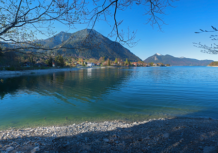beach of turquoise lake walchensee at early springtime, upper bavaria