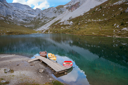 alpine lake partnun with rowing boats, switzerland