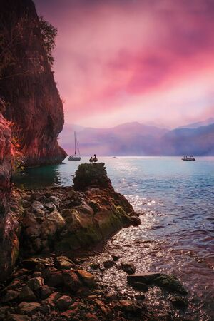 steep: romantic sunset mood at garda lake, coastal landscape with sunset sky, sailboat and ducklings