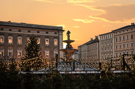 famous christkindlmarkt salzburg with illuminated christmas trees and garlands at sunset Stock Photo