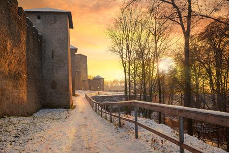 historic fortress battlement burgerwehr, old town salzburg with sunset sky