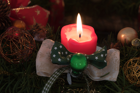 lighted red candle with robbon, detail shot of an handcrafted advent wreath Stock Photo