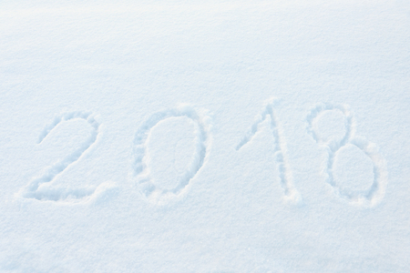 year 2018 written in snow - new years background