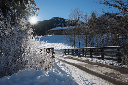 lonely road and hut in winter season, dreamy hiking area spitzing, upper bavaria Stock fotó
