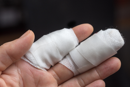 bandaged forefinger and middle finger, aided wound after a cat bite Stock Photo