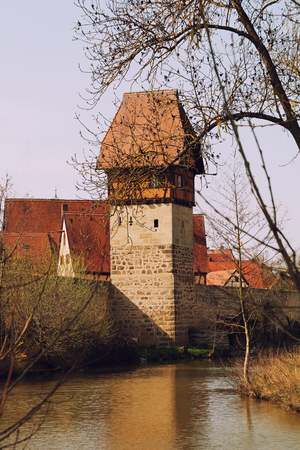 town wall and old tower of historic city dinkelsbuhl, middle franconia, moat with water 免版税图像