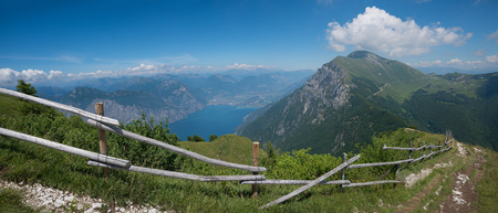 monte baldo summit - lookout point to riva town and garda lake. blue sky with copy space