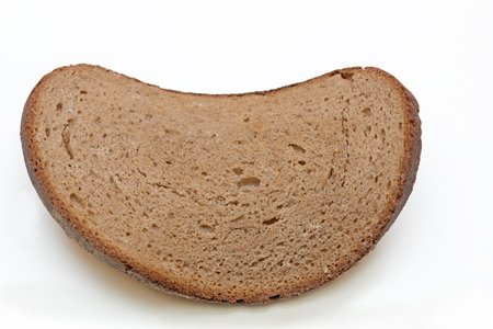 slice of an old dry bread, on white background