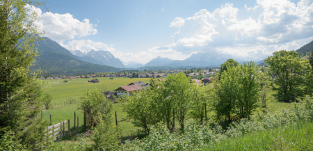 popular bavarian spa town wallgau in the valley, view to bavarian alps