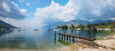 beautiful val di sogno cove near malcesine, with sailing boats and garda lake view. popular tourist destination north italy