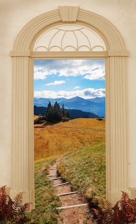 view through arched door, hiking trail in autumnal sunny mountain landscape swiss alps 스톡 콘텐츠
