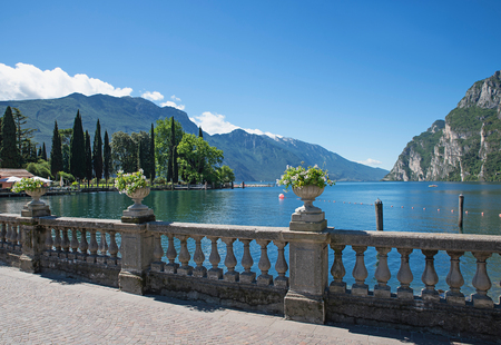 lakeside promenade riva with flower pots and lake view garda lake italy