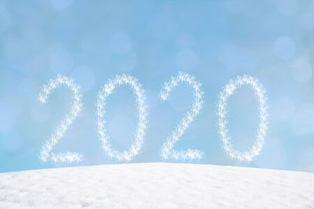 wintry background with flares and snowy hill. new years background 2020.