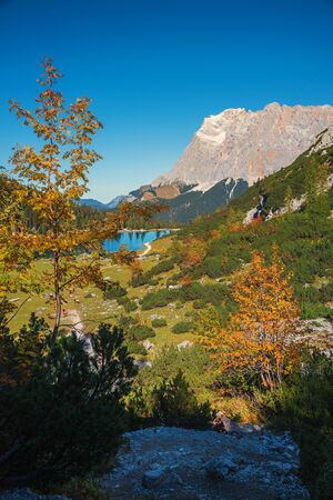 pictorial autumn landscape, hiking trail to Seebensee mountain lake and view to famous Zugspitze, austrian side Ehrwald.